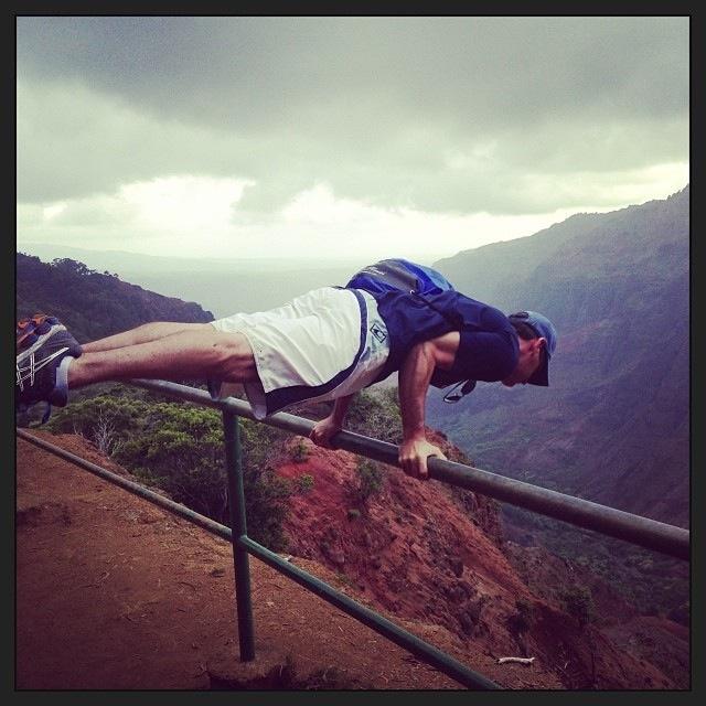 man doing yoga pose on hilke